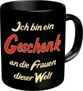 Tasse mit Fun Spruch: Ich bin ein Geschenk an die Frauen dieser Welt! witzige Kaffeetasse / Becher im Geschenkkarton, Kaffeepott